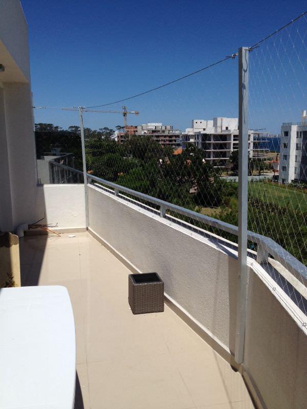 Colocacion de Red de proteccion en balcón con perfileria