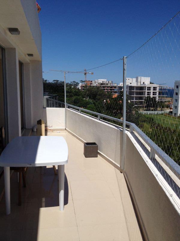 Colocación de Red de protección en balcón con perfileria